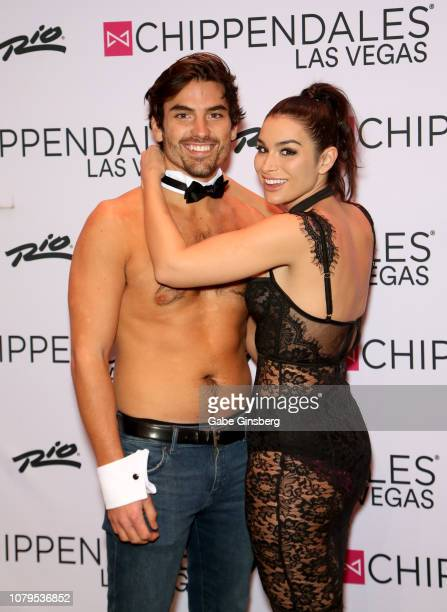 Television personalities Jared Haibon gets help from Ashley Iaconetti to get dressed for his performance at Chippendales at the Rio Hotel Casino on...