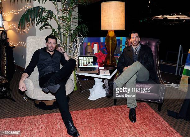 Television personalities Jonathan Scott and Drew Scott attend the Backstage Creations Celebrity Retreat at the American Country Awards 2013 at the...