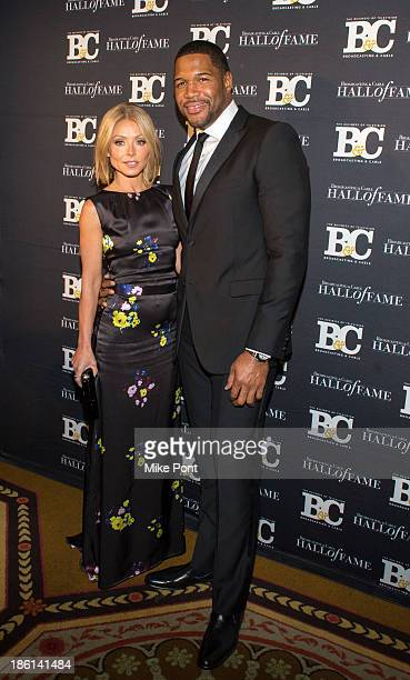 Television Personalities Kelly Ripa and Michael Strahan attend the Broadcasting and Cable 23rd Annual Hall of Fame Awards Dinner at The Waldorf...