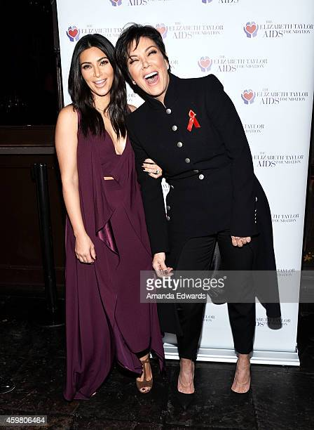 Television personalities Kim Kardashian and her mother Kris Jenner pose after raising a toast for the Elizabeth Taylor Foundation/World AIDS Day at...