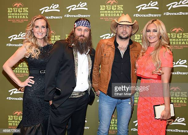 Television personalities Korie Robertson and Willie Robertson recording artist Jason Aldean and his wife Brittany Kerr attend the Duck Commander...