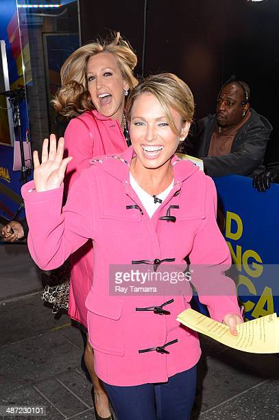 """Television personalities Lara Spencer and Amy Robach enter the """"Good Morning America"""" taping at the ABC Times Square Studios on April 28, 2014 in New..."""