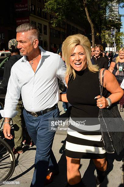 Television personalities Larry Caputo and Theresa Caputo leave the 'Today Show' taping at the NBC Rockefeller Center Studios on September 23 2014 in...