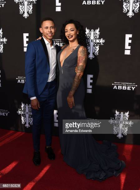 Television personalities Lawrence Carroll and Brandi J Andrews arrive at the premiere screening for E's What Happens At The Abbey at The Abbey on May...