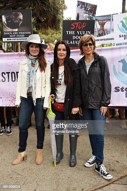 Television personalities Lisa Vanderpump Kyle Richards and Lisa Rinna attend the StopYulinForever March to End Dog Cruelty in Yulin China at...