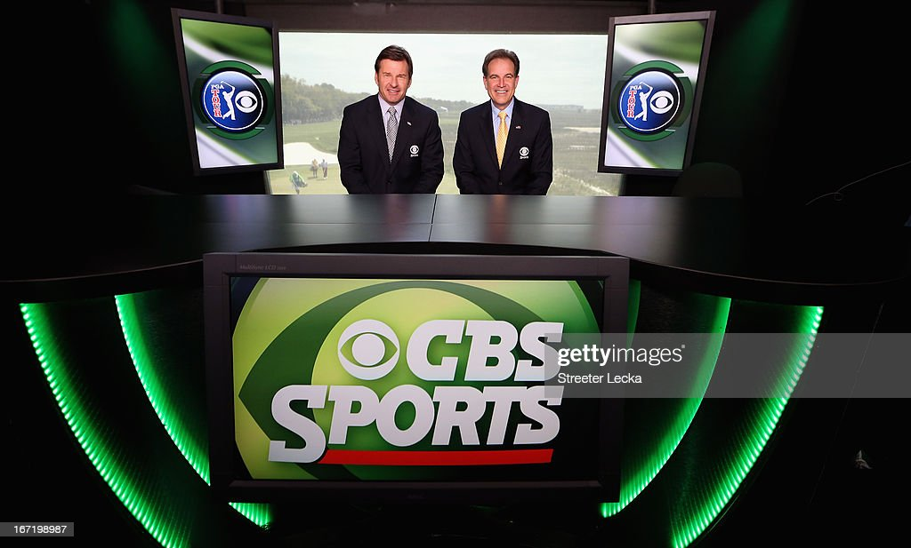 Television personalities Nick Faldo and Jim Nantz pose in the CBS Sports tower on the 18th hole during the final round of the RBC Heritage at Harbour Town Golf Links on April 21, 2013 in Hilton Head Island, South Carolina.