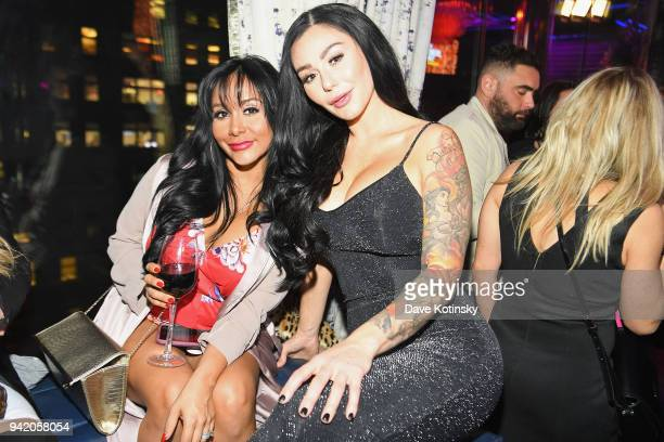 Television personalities Nicole 'Snooki' Polizzi and Jenni 'JWoww' Farley attend MTV's Jersey Shore Family Vacation New York premiere party at PHD at...