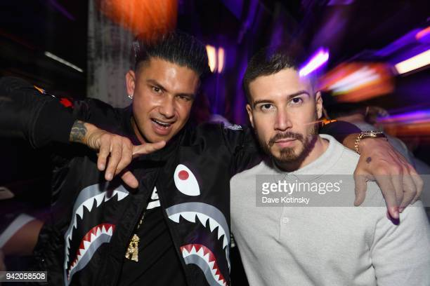 Television personalities Paul 'Pauly D' DelVecchio and Vinny Guadagnino attend MTV's 'Jersey Shore Family Vacation' New York premiere party at PHD at...