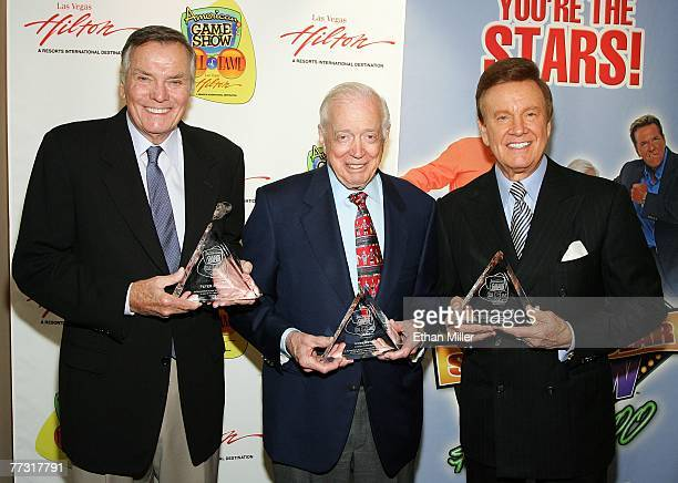 Television personalities Peter Marshall Hugh Downs and Wink Martindale pose after being inducted into the American TV Game Show Hall of Fame at the...