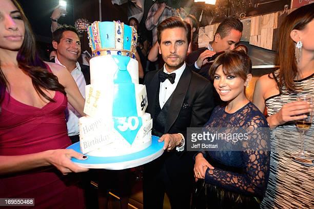 Television Personalities Scott Disick And Kourtney Kardashian Pose With His Birthday Cake As They Celebrate Scotts
