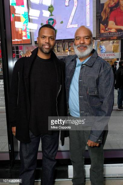 Television personality A J Calloway and Actor/comedian David Alan Grier pose for a picture at 'Extra' on November 28 2018 in New York City