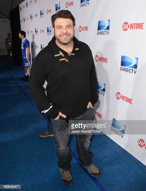 Television personality Adam Richman attends DIRECTV'S Seventh Annual Celebrity Beach Bowl at DTV SuperFan Stadium at Mardi Gras World on February 2...
