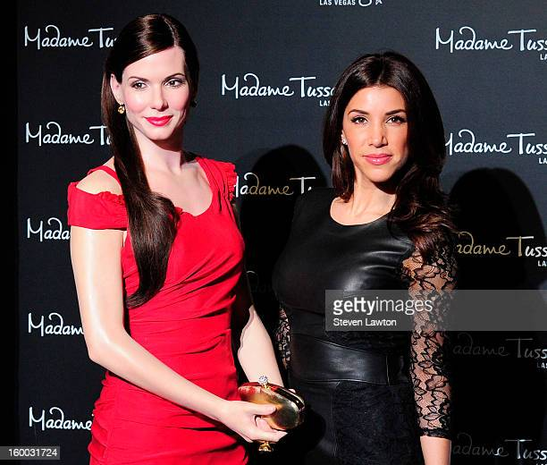 Television personality Adrianna Costa poses next to a wax figure of actress Sandra Bullock after is was unveiled at Madame Tussauds Las Vegas at The...