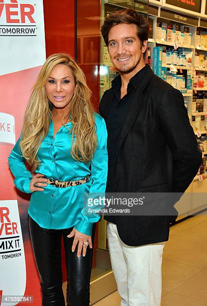 Television personality Adrienne Maloof and her boyfriend Jacob Busch appear at GNC Beverly Center to promote Never Hungover elixir at GNC at The...