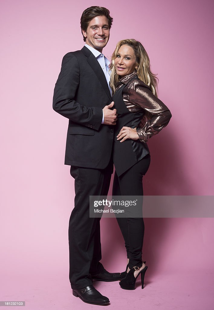 Television personality Adrienne Maloof (r) with boyfriend Jacob Busch attends Mark Kearney Group - 'Iced Out' Luxury Emmy Suite on September 19, 2013 in Los Angeles, California.