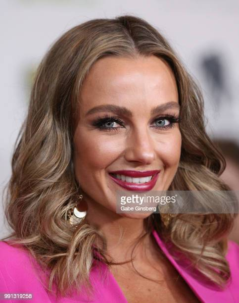 Television personality Amber Nichole Miller speaks to an interviewer during the 10th annual Fighters Only World Mixed Martial Arts Awards at Palms...