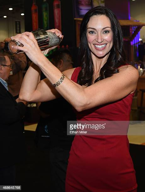 Television personality and bartender Mia Mastroianni makes a drink during the 30th annual Nightclub Bar Convention and Trade Show at the Las Vegas...