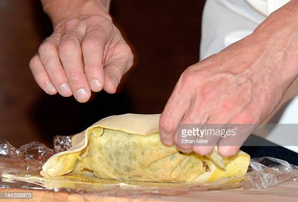 Television personality and chef Gordon Ramsay prepares a beef Wellington dish during a cooking demonstration and news conference held to celebrate...