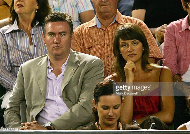 Television personality and Collingwood Football Club President Eddie McGuire and his wife Carla McGuire watch the the Men's Singles Final match...