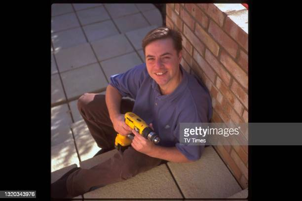 Television personality and DIY expert 'Handy' Andy Kane, best known for the home improvement series Changing Rooms, circa 1997.