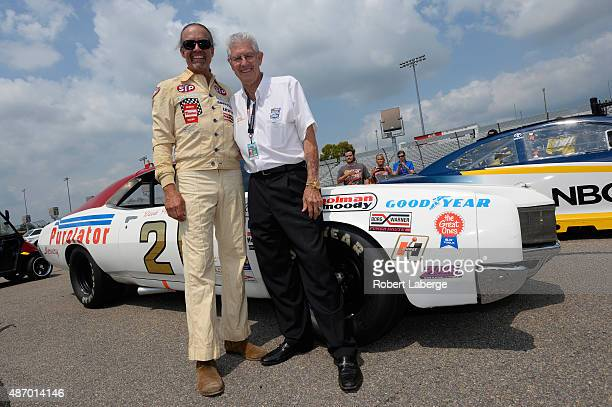 Television personality and fomer NASCAR driver Kyle Petty, left, poses with NASCAR Hall of Famer Leonard Wood and the Wood Brothers Racing 1972...