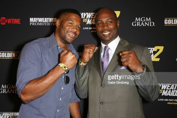 Television personality and former NFL player Michael Strahan and former heavyweight champion Lennox Lewis arrive at Showtime's VIP prefight party for...