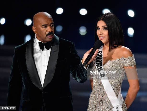 Television personality and host Steve Harvey onstage with Miss Colombia 2017 Laura Gonzalez as she answers a question during the interview portion of...