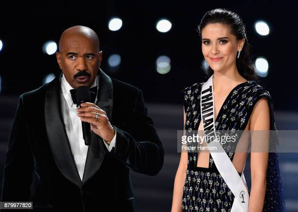 Television personality and host Steve Harvey onstage with Miss Thailand 2017 Maria Poonlertlarp as she answers a question during the interview...