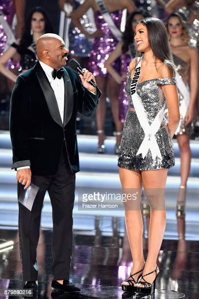 Television personality and host Steve Harvey speaks with Miss Croatia 2017 Shanaelle Petty after she is named a top 16 finalist during the 2017 Miss...