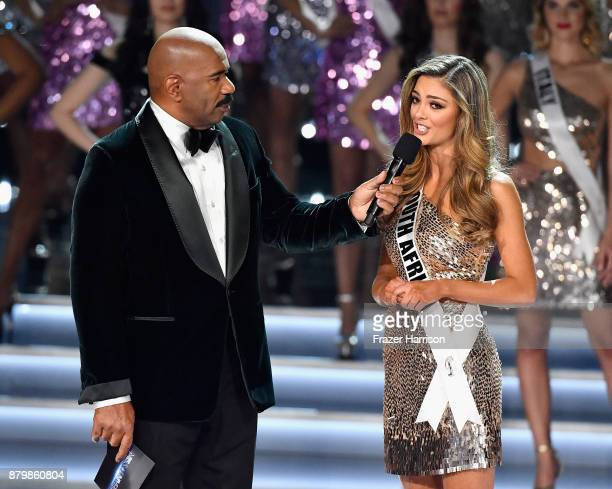 Television personality and host Steve Harvey speaks with Miss South Africa 2017 DemiLeigh NelPeters after she is named a top 16 finalist during the...