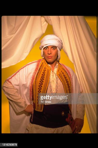 Television personality and interior designer Laurence Llewelyn-Bowen wearing robes and a keffiyeh in the style of T.E. Lawrence, better known as...