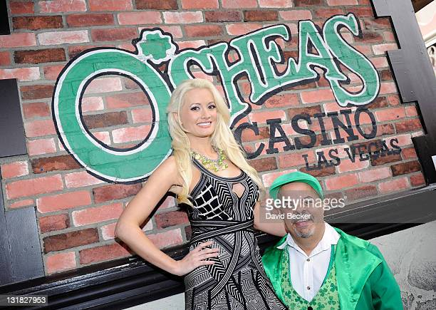 Television personality and model Holly Madison and O'Sheas' Lucky Leprechaun Brian Thomas pose for a postgame picture after Madison beat Thomas in a...