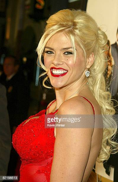Television personality Anna Nicole Smith walks on the red carpet during MGM's premiere of Be Cool at Grauman's Chinese Theatre on February 14 2005 in...
