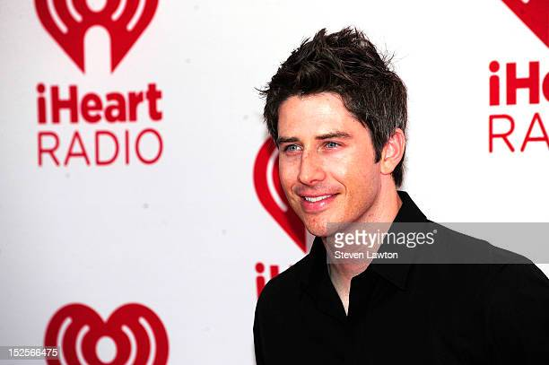 Television personality Arie Luyendyk Jr poses in the press room at the iHeartRadio Music Festival at the MGM Grand Garden Arena September 21 2012 in...