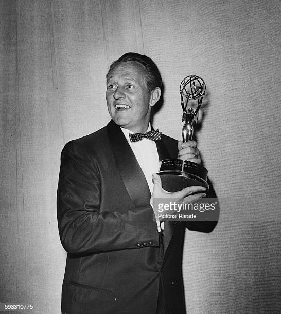 Television personality Art Linkletter holding a statuette as he presents the Primetime Emmy Awards, circa 1955.