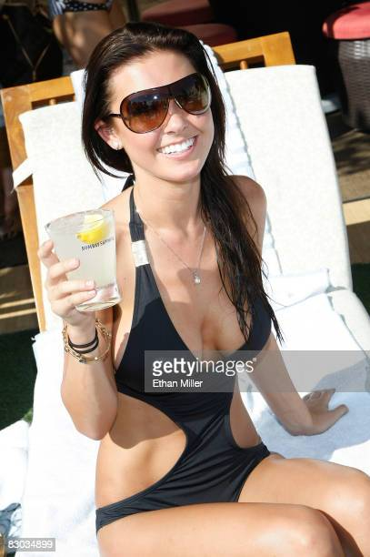 Television personality Audrina Patridge poses while hosting a Bombay Sapphire event at the Wet Republic pool at the MGM Grand Hotel/Casino September...