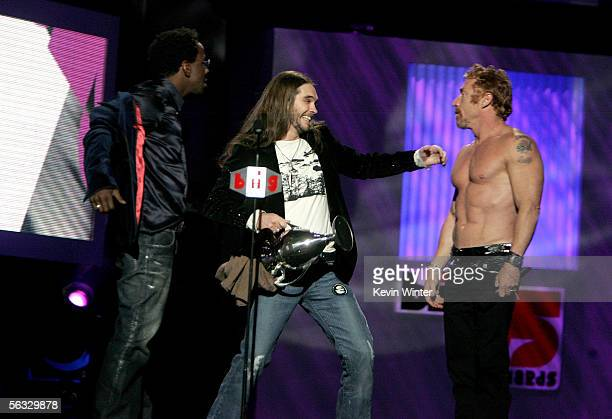 Television personality Bo Bice accepts his award for Big Reality Star as actor Danny Bonaduce and singer Bobby Brown look on onstage at the VH1 Big...