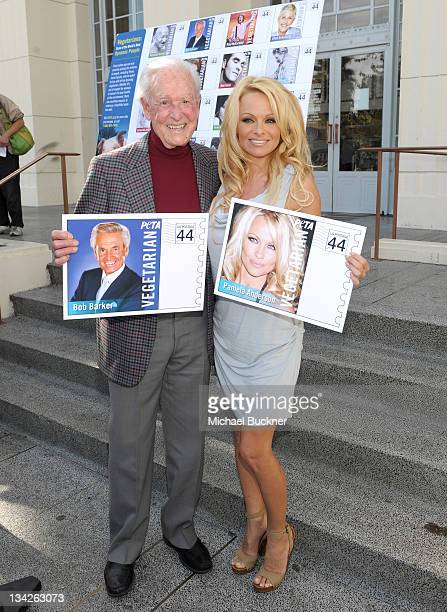 Television personality Bob Barker and actress Pamela Anderson unveil the Vegetarian Icons Postage Sheet at Hollywood Post Office on November 29 2011...