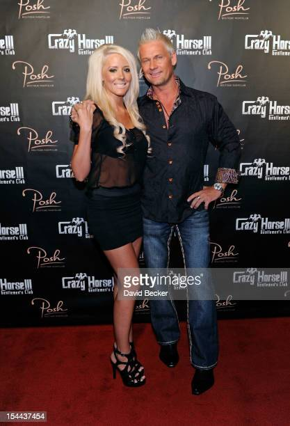 Television personality Brace Land and Lindsay Perkins arrive at the Crazy Horse III Gentlemen's Club at Playground on October 19 2012 in Las Vegas...