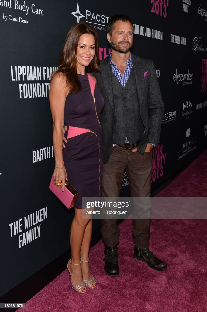 Television personality Brooke Burke-Charvet (L) and actor David Charvet attend Elyse Walker Presents The Pink Party 2013 hosted by Anne Hathaway at Barker Hangar on October 19, 2013 in Santa Monica, California.