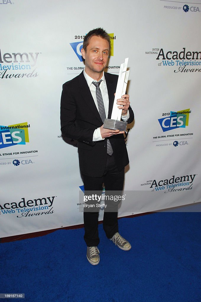 Television personality Chris Hardwick poses with the IAWTV award for Nerdist Channel Best Online Channel at the IAWTV Awards at the CES 2013 Show at the Palazzo Theater at the Palazzo Resort Hotel/Casino on January 8, 2013 in Las Vegas, Nevada.