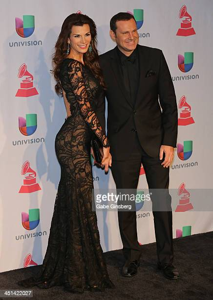 Television personality Cristina Bernal and Alan Tacher pose in the press room during The 14th Annual Latin GRAMMY Awards at the Mandalay Bay Events...