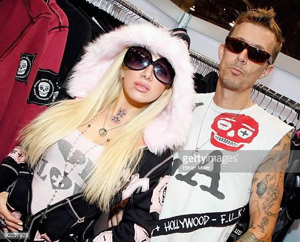 Television personality Daisy De La Hoya from the VH1 series Daisy of Love and SYC FUK designer Bucky Bakes appear at the SYC FUK booth at the MAGIC...