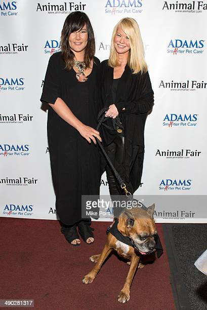Television Personality Diane McInerney with dog Jake and guest attend the 12th Annual Animalfaircom Paws For Style Fashion Show at Pacha on May 13...