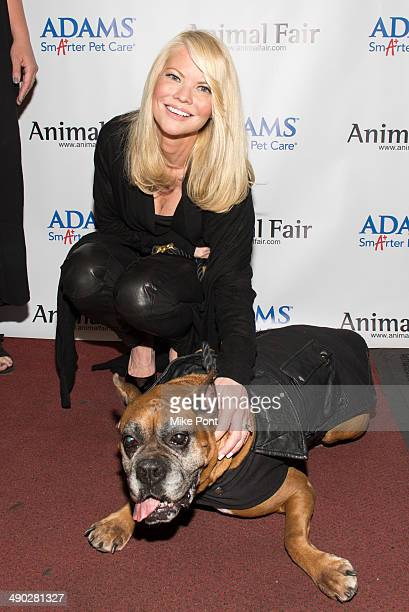 Television Personality Diane McInerney with dog Jake attends the 12th Annual Animalfaircom Paws For Style Fashion Show at Pacha on May 13 2014 in New...