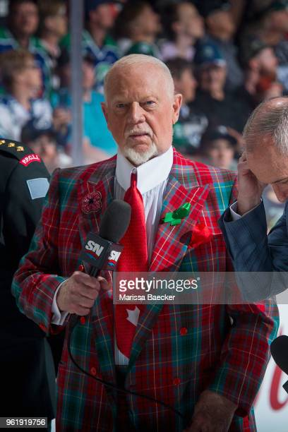 Television personality Don Cherry of Coaches Corner stands on the ice at the start of game four of the MasterCard Memorial Cup between the Hamilton...
