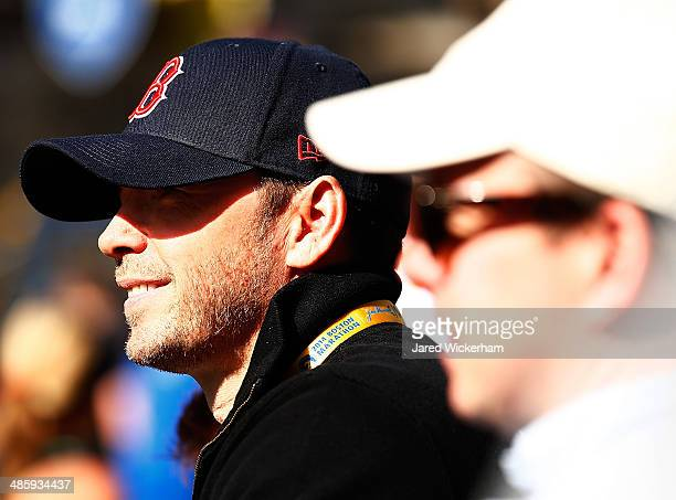 Television personality Donnie Wahlberg watches runners come across the finish line during the 2014 BAA Boston Marathon on April 21 2014 in Boston...