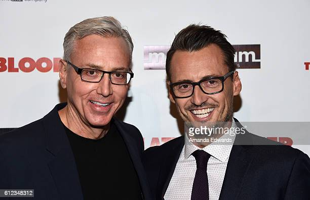 "Television personality Dr. Drew Pinsky and author Ken Baker arrive at the premiere of Momentum Pictures' ""The Late Bloomer"" at iPic Theaters on..."