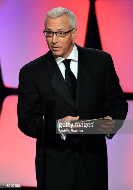 Television personality Dr Drew Pinsky onstage during The 39th Annual Daytime Emmy Awards broadcasted on HLN held at The Beverly Hilton Hotel on June...
