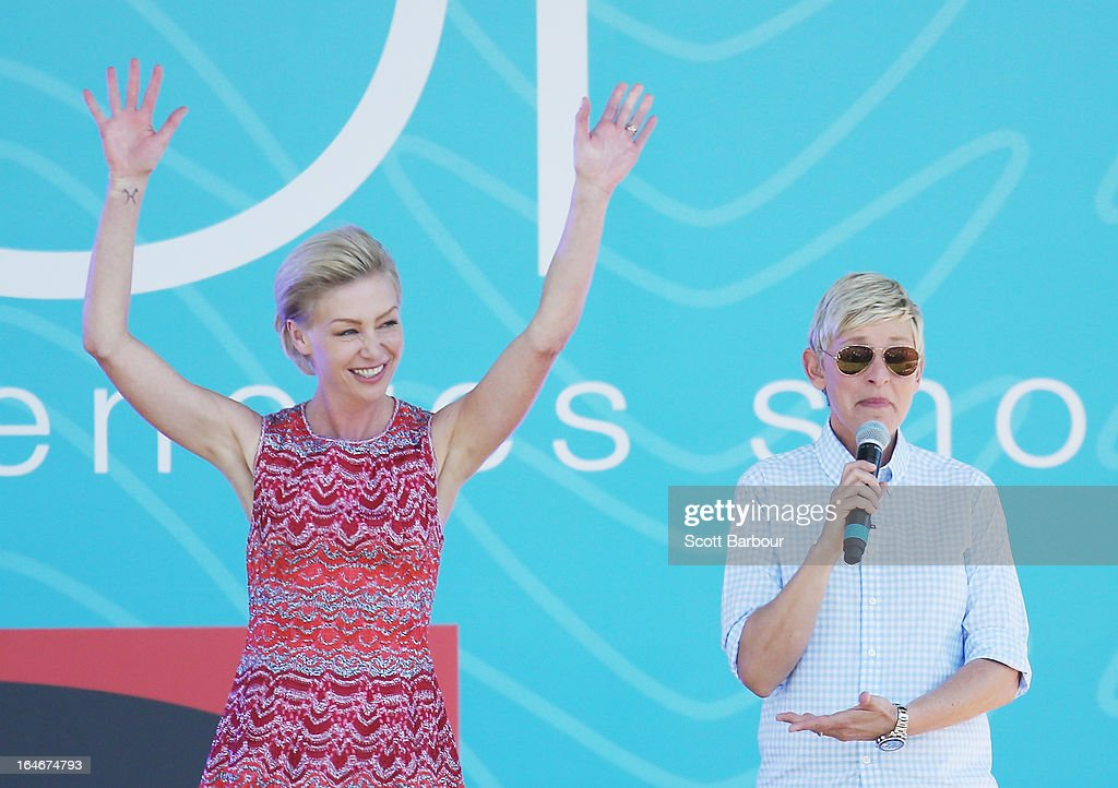 Television personality Ellen DeGeneres (R) and her wife Portia de Rossi appear on stage during the filming of her television show at Birrarung Marr on March 26, 2013 in Melbourne, Australia. DeGeneres is in Australia to film segments for her TV show, 'Ellen'.